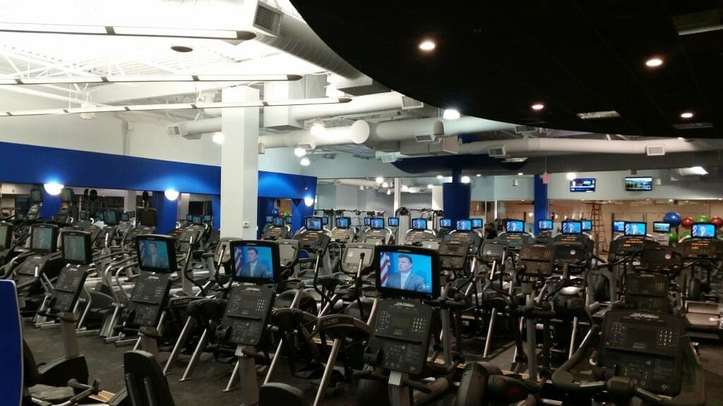 TVs and monitors set up on the stationary bikes