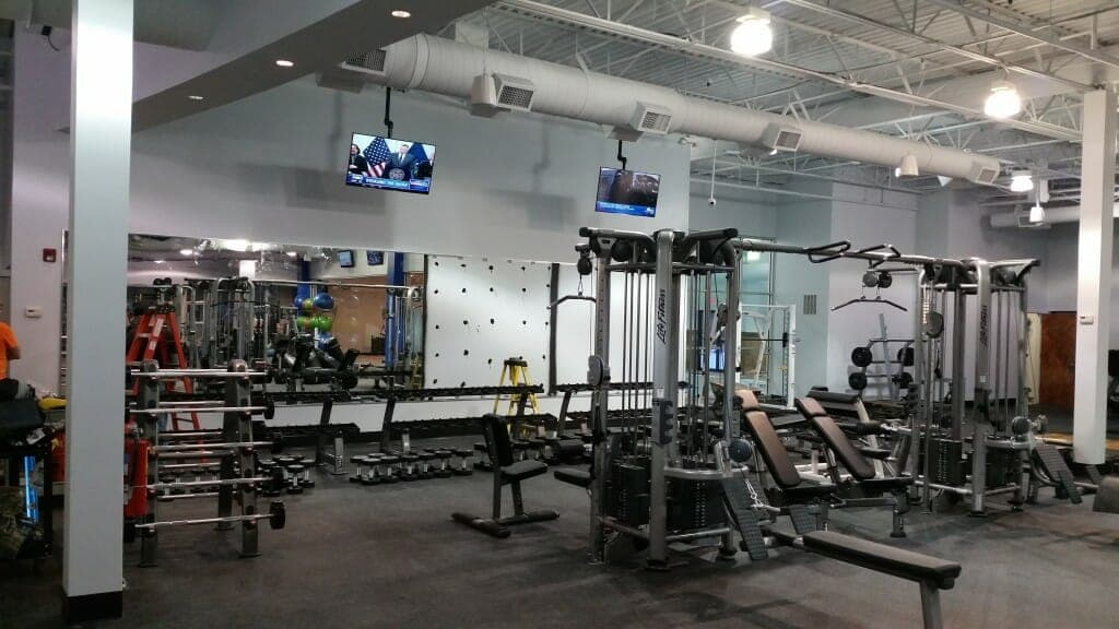 TVs installed in weight training room