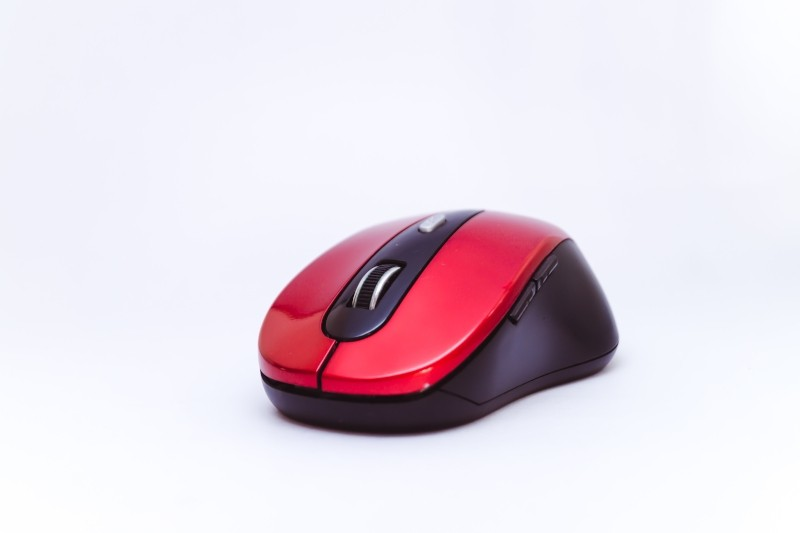 Red computer mouse on white background