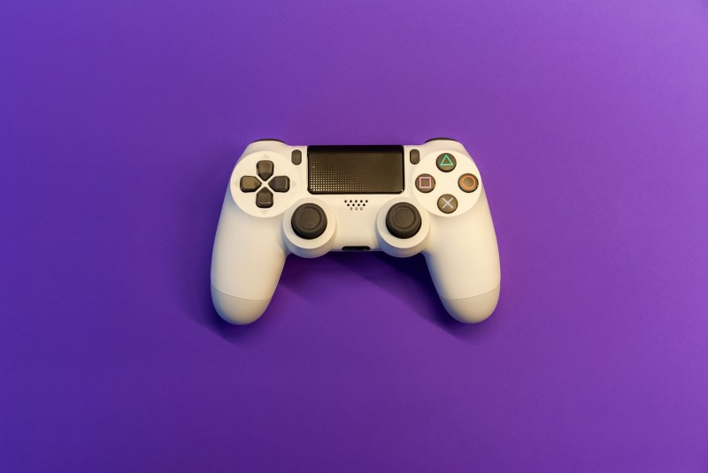white playstation controller on purple backdrop