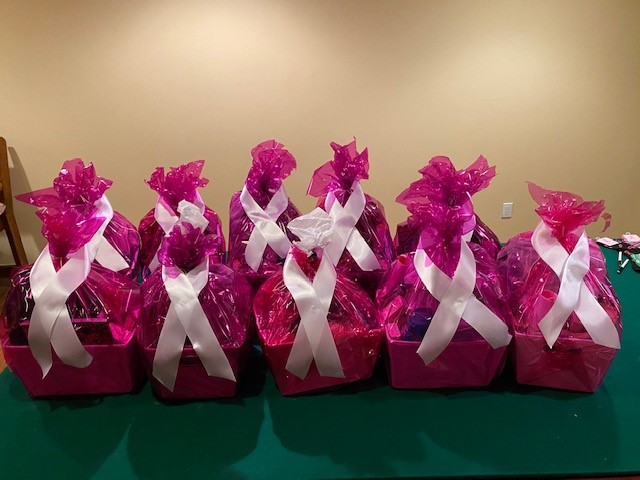 Packages wrapped in pink sitting on table
