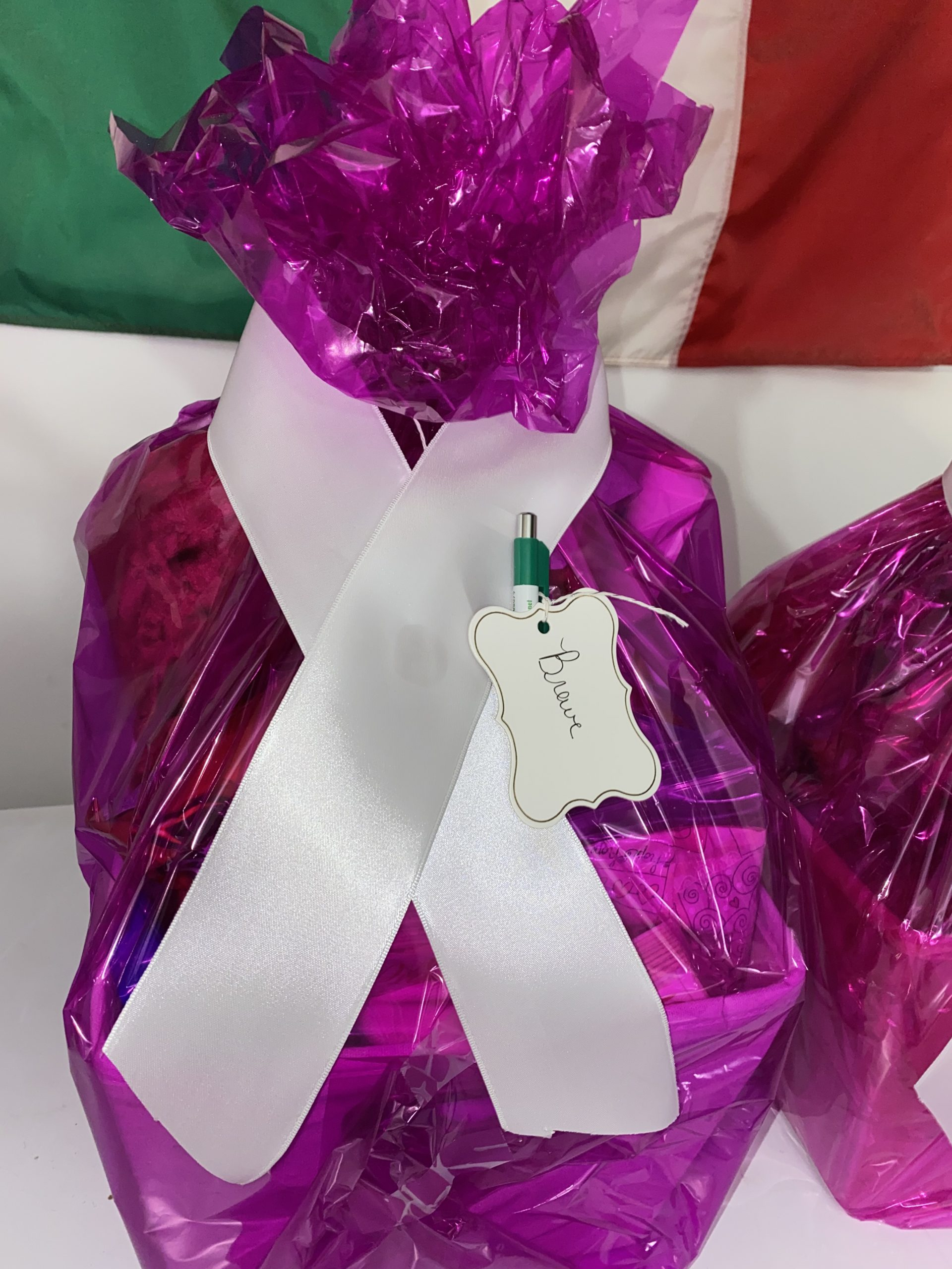 Package with ribbon and tag saying Brave