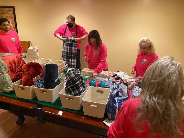 Green Tech employees putting the gifts together