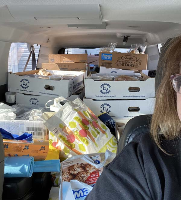 Groceries and meals in back of vehicle behind the driver