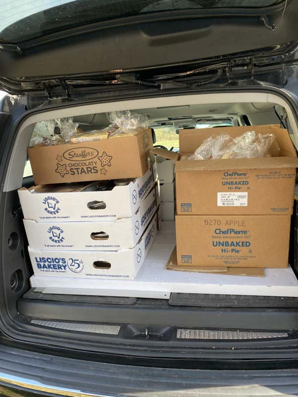 Boxes with meals loaded in back of car