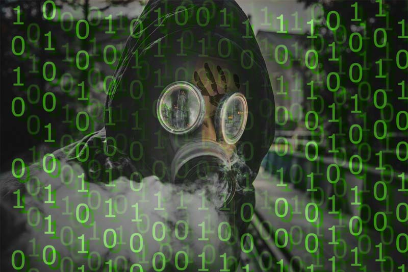 Person in hooding wearing gas mask with matrix-like digits over picture