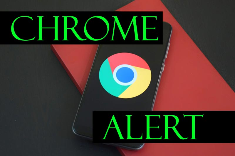 """Cellphone with Google Chrome logo on it and words """"Chrome Alert'"""